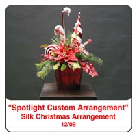 December Spotlight Christmas Flower Arrangement using Candy Canes,poinsettias, peppermints and pine