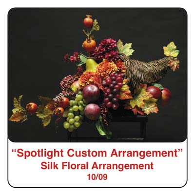 October Spotlight Thanksgiving and Fall Cornucopia Arrangement using Fall leaves, grapes, apples, pomegrantes, silk flowers, and silk foliage, and artificial berries