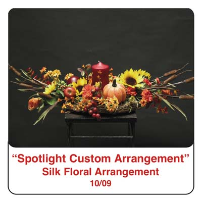 October Spotlight Thanksgiving and Fall Centerpiece using a candle, pumpkin, cattails, roses, berries, artifical berries, sunflowers, and silk foliage