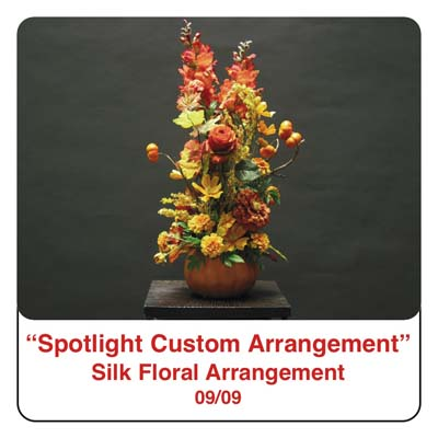 September Spotlight Thanksgiving and Fall Arrangement in a pumpkin using silk flowers and silk fall leaves and foliage