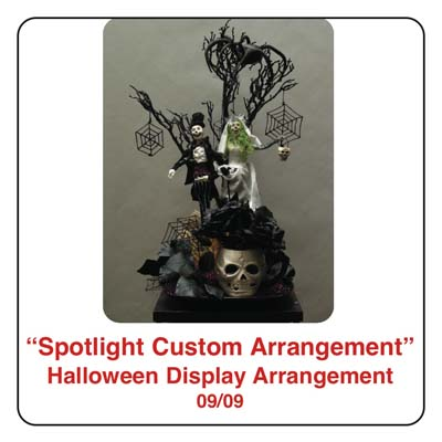 September Spotlight Halloween Arrangement and Display using skeletons, spiders, spider webs, a black tree, and zombies