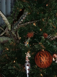 christmas tree with feathers animal print and giraffe ornament